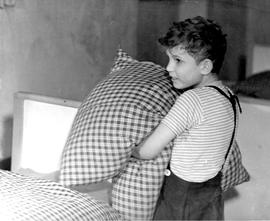 [Germany]: UNRRA / 1900 : Kloster Indersdorf, Germany, Bed time, and Peter fixes up the covers in...