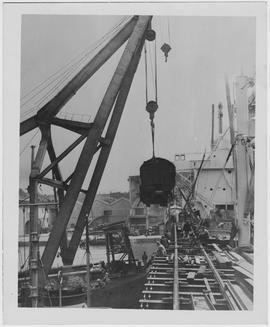 100-ton Baldwin locomotive being unloaded at the Chang Wah Pang Railway Wharf near Woosung, one o...