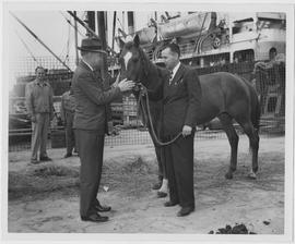 William Green, left, UNRRA agricultural rehabilitation officer in the China office, and Edwin R H...