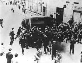 Citizens of the Danish city of Odense rush to stop a prison van loaded with local compatriots arrested by the Germans