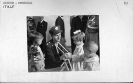 [Italy] Capt. Eleanor Gochanour, of the Medical Division of UNRRA, shows the children how to play...