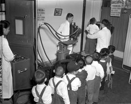 CNRRA / 766 The free-of-charge mass X-raying of 300 Chinese tots per day between the ages of 5 and 9 years is under way at the Shanghai Anti-Tuberculosis Clinic on Avenue Haig with the aid of an UNRRA-supplied Philips Mass X-ray unit installed by WHO