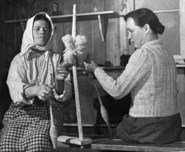 [Germany]: UNRRA / 3049 : Hohenfels, Germany, Wool from the sheep at the Hohenfels farm is spun by Anna Czura and Marismroz (right) and then made into socks and mittens by Polish girls at the center.