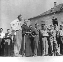 [Germany] : UNRRA  871 : Heilbronn, Germany, Group of Displaced Persons liberated from Dachau, some still in prison clothes, now at Heilbronn camp.