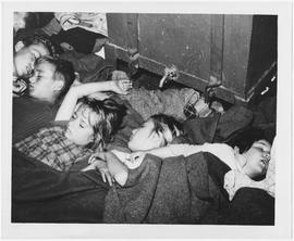 [Middle East] Young refugees relaxed in deep sleep after a hard day of studying and playing on bo...