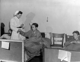 [Germany]: UNRRA / 3057: Wertheim, Germany, Miss Lily Ruiga (former DP) at the Displaced Persons ...