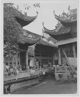 One of the bad examples of emergency housing in China is this bombed Buddist [ie Buddhist] temple in Hankow where hundreds of Hankow natives are living on their return from free China