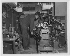 [Man operating machinery, Shanghai, China, July 1947]