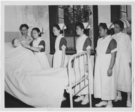 Miss Ray is shown with student nurses in nursing arts class