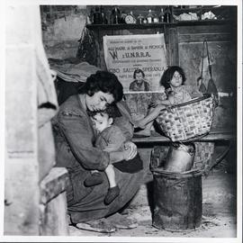 [Italy] Victims of war far removed from light and air, this mother and her children, in one of th...