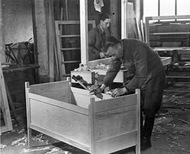 [Germany]: UNRRA / 3051: Coburg, Germany, Stanislaw Kraykowish, of Warsaw, finishes a crib in the carpenter shop.