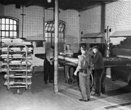 [Germany]:  UNRRA / 3059 : Hanau, Germany, Workmen in the huge bakery, formerly German, which is ...