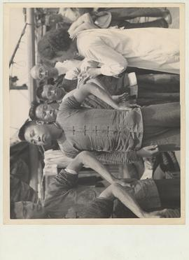 A nurse of the Shanghai Quarantine Service inoculates the crew of a junk with cholera vaccine