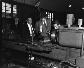 CNRRA / 718 UNRRA Director-General Lowell W Rooks inspects the machine shop of the CNRRA-MOAF off...