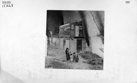 [Italy] Forced underground, not by air-raids but through lack of housing, this ragged mother &amp...
