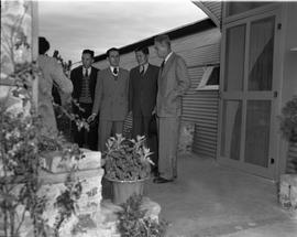 CNRRA / 726 Director-General Lowell W Rooks (right) inspecting the small, clean hospital unit, ma...