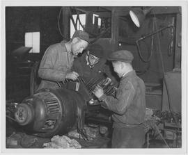 [Men examining machinery, Shanghai, China, July 1947]