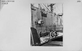 [Italy] Sacks of flour, part of cargo of 8,000 tons, being unloaded from S.S. Walter Fleming into...