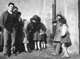 [Italy] Miss Phoebe Bannister, Director of Welfare for UNRRA, talks to an Italian refugee child w...