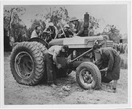 Inspecting a newly arrived tractor at the UNRRA-MOAP [ie MOAF?] centre, Point Island