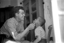 [Greece] Lieut. Albert Mendeloff, U.S. Public Health Service, examines children on the Island of ...