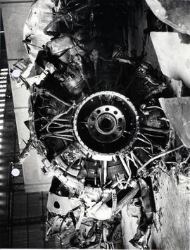 Front view of NO. 1 engine after reduction gear had been removed. Tips of propeller blades are in...