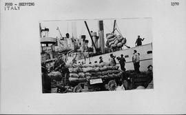 "[Italy] Unloading UNRRA's first consignment of seed potatoes from the ""Arnhem"" at the d..."