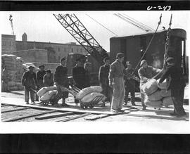 [Italy] Barley being loaded on ship for Yugoslavia.