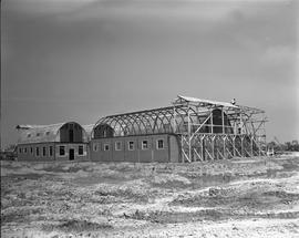 CNRRA / 500 The many-purpose wartime quonset hut, now serving many peacetime needs, lends itself ...