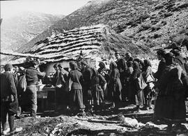 [Greece] Villagers from the surrounding country come to this roadside hut of the village of Mousi...