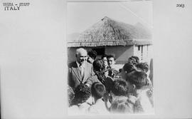 [Italy] Herbert H. Lehman, Director General of UNRRA is surrounded by children during his visit t...