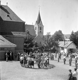 [Germany] : UNRRA 3074 -- Rottweil, Germany -- UNRRA camp at Rottweil, Germany where a group of Polish displaced persons are seen in folk dance in school yard.