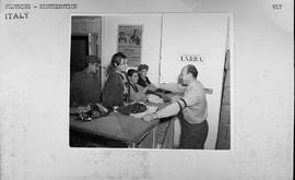 [Italy] The members of the family gratefully shake hands with an official at the UNRRA commissary...