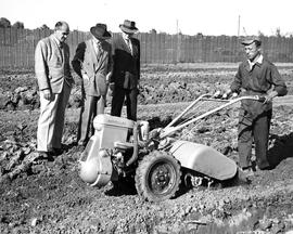 CNRRA / 712  Director-General Lowell W Rooks (center) watching the workings of one of the 40 UNRRA-supplied Rototillers, a one-man gas-driven cultivator