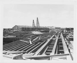 Two 85-foot UNRRA pile drivers tower above the 400-foot extension of the Chang Wah Pang Railway W...