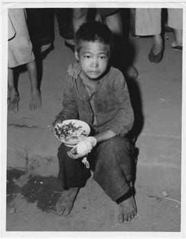 Homeless starving child famine refugee on streets of Hengyang, Hunan Province, into which in rece...
