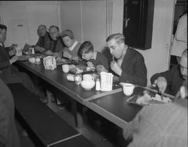 CNRRA / 327 Refugee passengers aboard the Marine Falcon having their first meal on ship -- sauerk...