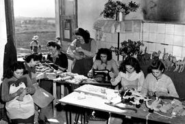 [Italy] At one of UNRRA's Italian refugee camps, girls are at work in the Doll Shop, making toys ...
