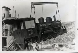 [Yugoslavia] One of five UNRRA locomotives on the SS John Eaton swings ashore at Dubrovnik, Yugos...