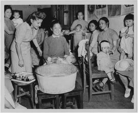 The Shanghai Mother's Club of the Child Welfare and Maternal Health Clinic receives instructions from UNRRA Public Health Nurse Irene Muir on child care