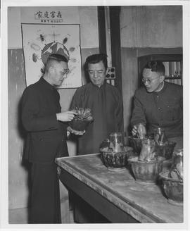 Tso Shun-Sheng, center, shown in the testing laboratory of the UNRRA-MOAF-sponsored National Pest...