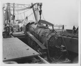 100-ton Baldwin locomotive being unloaded at the Chang Wah Pang Railway Wharf near Woosung, one of 268 heavy steam engines imported by UNRRA for China's railways