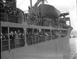 CNRRA / 333 A group of refugee passengers on the deck of the Marine Falcon leaning on the rails t...