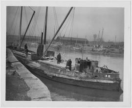 One of the barges bearing 1,000 tons of UNRRA flour arriving at the China Merchants Navigation Co...