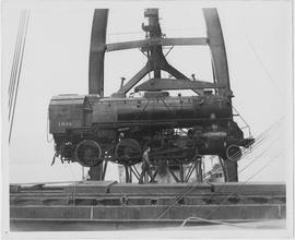 100-ton Baldwin locomotive being unloaded at the Chang Wah Pang Railway Wharf near Woosung, one of 268 heavy steam engines for China's railways, imported by UNRRA