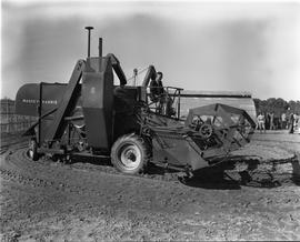 CNRRA / 716 Combine tractor at the Agricultural Experimental Farm at the CNRRA-MOAF office, Point...