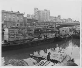 Diesel-operated 150 kilowatt electrical generators brought here by UNRRA for the rehabilitation of China's war-shattered municipal and industrial power plants float on barges in Shanghai's Soochow Creek after being unloaded from the SS Atwater Park