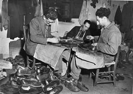 [Italy] These Austrian and Czech refugees are employed by UNRRA to repair shoes which will be dis...