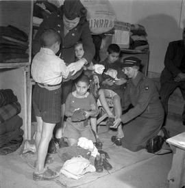 [Greece] These Greek boys, victims of malnutrition, being outfitted with clothes at UNRRA warehou...