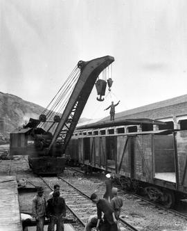 CNRRA / 463 Chinese workmen assemble one of the 3,445 freightcars contributed by UNRRA as part of...